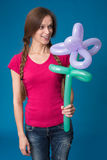 Girl with balloon flower Stock Photos