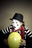 Girl with a balloon in the form of mime actor Stock Photo