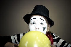 Girl with a balloon in the form of mime actor Royalty Free Stock Photography
