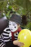 Girl with a balloon in the form of mime actor Royalty Free Stock Images