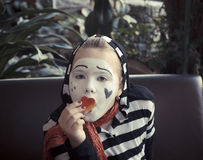 Girl with a balloon in the form of mime actor Stock Images
