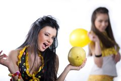 Girl with balloon and girl with fruit Stock Photo