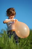 Girl  with  balloon in grass Stock Image
