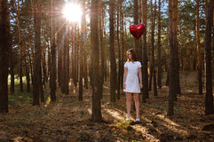 Girl with a balloon in the heart of the forest Stock Photography