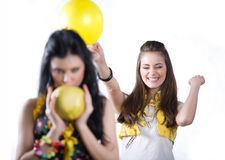 Girl with balloon and nice girl with fruit Royalty Free Stock Images