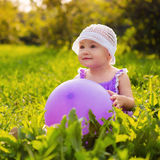 Girl with a balloon outdoors Royalty Free Stock Photos