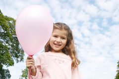Girl with balloon in park. Stock Photo