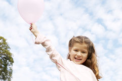 Girl with balloon in park. Stock Images