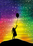 The girl with the balloon on the sky Stock Photo