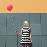 Girl with balloon Stock Photo