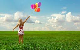 The girl with balloons Stock Photos
