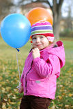 Girl with balloons Royalty Free Stock Images