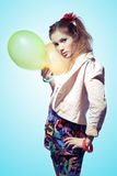 Girl with balloons. Pretty girl holding balloons on blue background Stock Photo