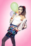 Girl with balloons. Beautiful girl with colorful balloons on pink background Stock Photography