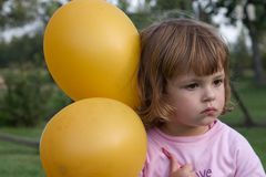 Girl with balloons Stock Images