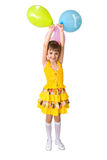 The girl with balloons. The girl in yellow clothes with balloons Stock Photos