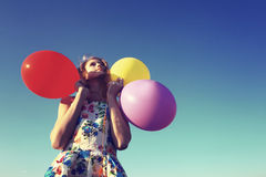 Girl with balloons. A dream,a hope,a fantasy. Stock Photo