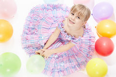 The girl with balloons Stock Image