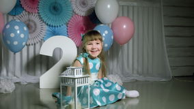 Girl with balloons and figure 2 stock video footage