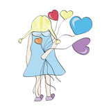 Girl with balloons. In the form of hearts on Valentine's Day Stock Photography