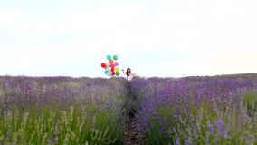 Girl with balloons in the lavender field stock footage