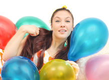 Girl with balloons look at camera Royalty Free Stock Photo