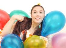 Girl with balloons look at camera Royalty Free Stock Photo