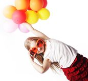 Girl with balloons and orange sunglasses Royalty Free Stock Photos