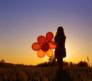 Girl with balloons outdoor Royalty Free Stock Photos