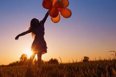 Girl with balloons  outdoor Stock Photos