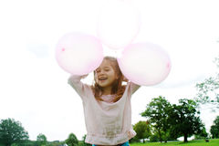 Girl with balloons in park. Stock Image