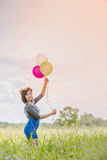 The girl with balloons Royalty Free Stock Photo