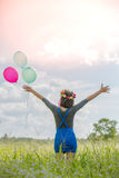 The girl with balloons Stock Photography