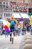 Girl with balloons ride to Amsterdam Stock Photos
