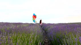 Girl With Balloons Runs In Lavender stock video
