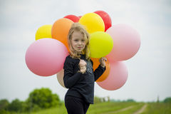 Girl with balloons. Stock Images