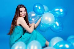 Girl with balloons in studio Stock Images