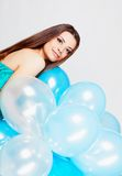 Girl with balloons in studio Royalty Free Stock Images