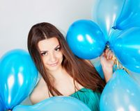 Girl with balloons in studio Royalty Free Stock Image
