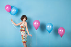 Girl with balloons in studio. Stock Image