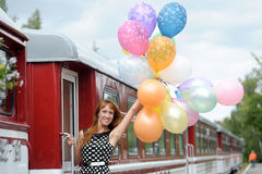Girl with balloons. And train stock photos