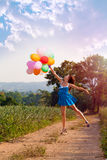 The girl with balloons. Vintage style Stock Photography