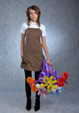 Girl and balloons Stock Images