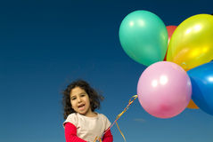 Girl and baloons Stock Images