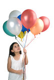 Girl and baloons. Girl holding balloons isolated on white Stock Photos