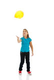 Girl with baloons looking up Stock Photo