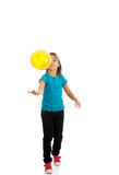Girl with baloons looking up Royalty Free Stock Images