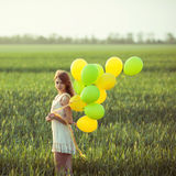 Girl with baloons Stock Photos