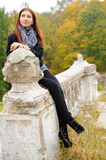 Girl on balustrade. Beatiful girl sits on the old balustrade Stock Photography