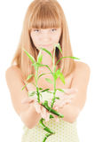 Girl with bamboo sprout Royalty Free Stock Photo